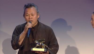 """קים קי-דוק, במאי """"פייטה"""" זוכה פרס הסרט הטוב ביותר של פסטיבל ונציה 2012. צילום: הפסטיבל."""