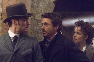 מימין: רייצל מקאדמס, רוברט דאוני גוניור וגוד לאו. מתוך שרלוק הולמס.