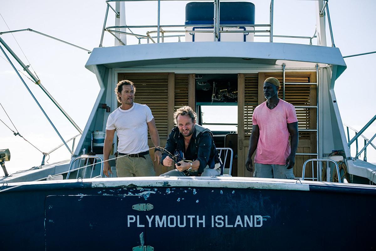 """תמונה של דג'ימון הונסו עם ג'ייסון קלארק, מתיו מקונוהיי מתוך """"מים שקטים"""""""